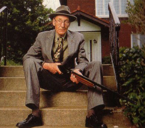 William S. Burroughs with a shotgun