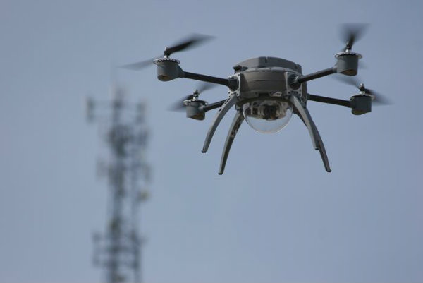 An aerial drone hovers in the air